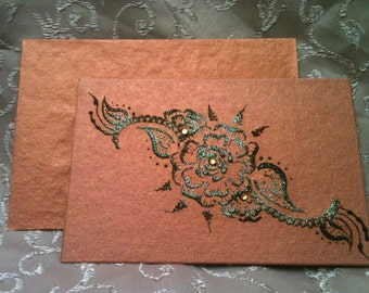 Blank metallic copper note card with henna design and glitter