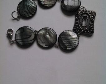 Stone bead and lock bracelet
