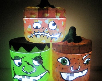 JACK-O JARHEADS Halloween lanterns from recycled Plastic jars magically turn into BOOtiful Glowing Ghouls.