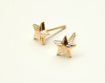 on sale! Mini Gold Star Earrings
