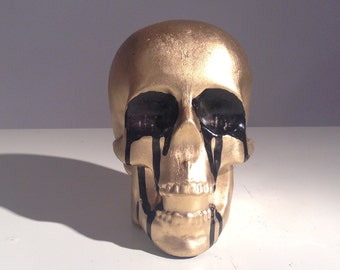 One of a kind human skull sculpture- casted and hand painted with gold and black enamel