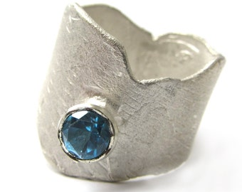 Sculptural Silver Ring with London blue Topaz