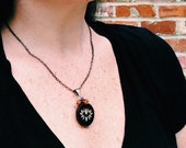 Gunmetal Necklace with Large Lotus Pendant and Stone Cluster