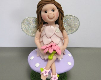 Fairy sitting on a Mushroom polymer clay Cake Topper MADE TO ORDER