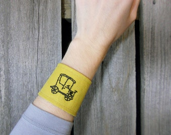 Cuff bracelet made from reclaimed and vintage materials/ old fashioned automobile/Eco wear/ mustard yellow and black/ inspirational jewelry