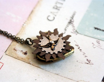 bird heart. locket necklace. brown and brass ox color tones