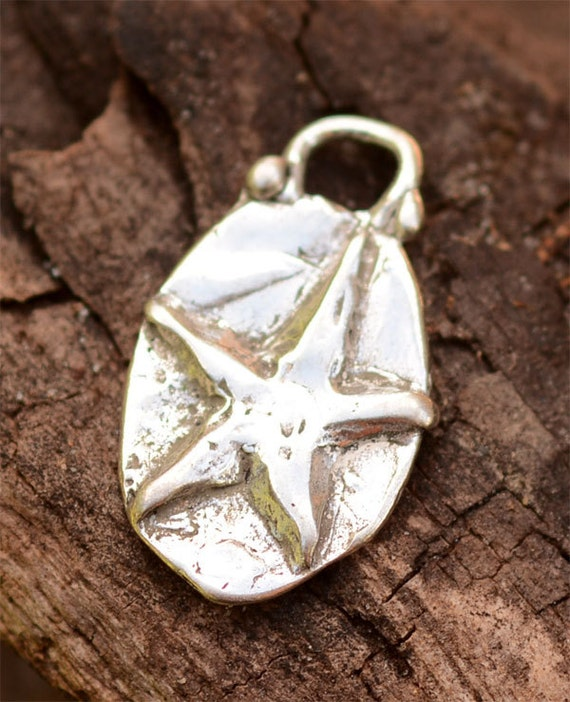 Star on an Oval Charm in Sterling Silver