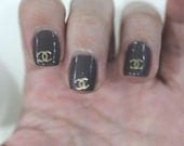 Buy 2 get 1 free. 20 pcs Gold or Silver designer Logo nail art soft metal