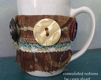 fabric bracelet wrist cuff coffee cup cozy handmade with large vintage buttons and upcycled fabric