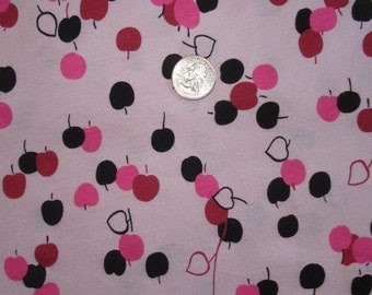 Apples on pink cotton jersey knit fabric