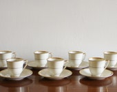 Set of 7 porcelain espresso cups with saucers