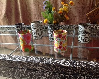Decoupaged cans for flowers or pencils and pens