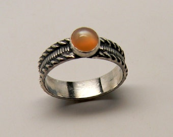 Sterling silver stacking ring with peach monnstone gemstone.