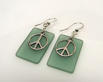 Beach glass jewelry earrings with peace sign charms.
