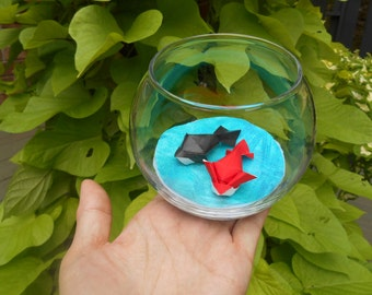Red and Black Origami Goldfish swimming in a Round Bowl