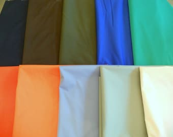 Polyurethane laminate WATERPROOF soft durable fabric blues brown greens orange stretch