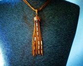 Monet style vintage 70s multi chain gold tone metal necklace with extra large tassel pendant.