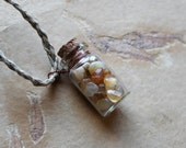 Tumbled Oregon beach agate in glass bottle necklace with hand-braided hemp cord - simple nature jewelry - mineral totem