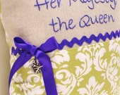 """hand embroidered pillow- """"Her Majesty , the Queen""""  in purple on linen with green and white scroll print and crown charm READY TO SHIP"""