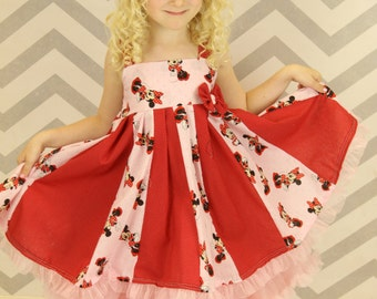 custom boutique dress made with minnie mouse  fabric size 2-6