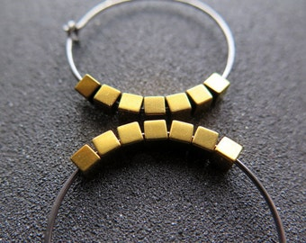 gold and silver earrings. hypoallergenic niobium hoops for sensitive ears.