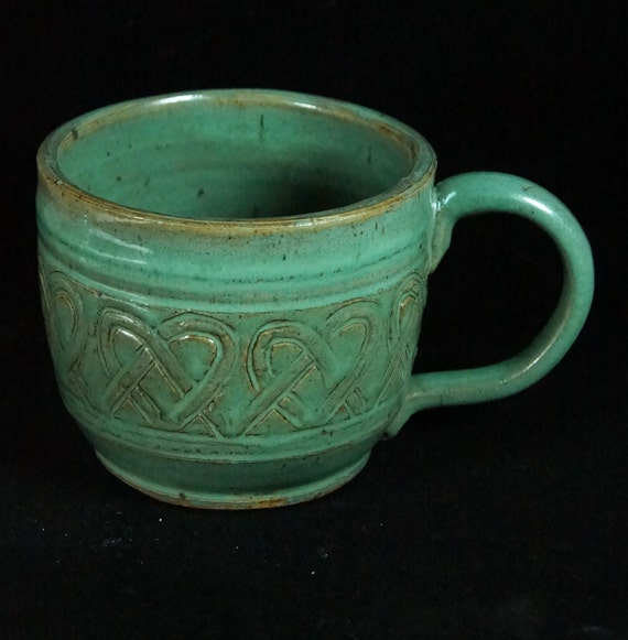 Carved Pottery Mugs