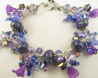 Purple,blue, aqua, and lavender beaded Charm Bracelet with Lampwork Beads, Handmade by Harleypaws SRAJD