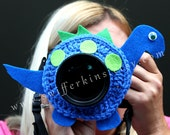 Blue Dinosaur lens buddy. Camera critter. Photographer helper