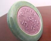 handmade wine bottle stopper with reusable tapered cork stamped put a cork in it design light purple green glaze