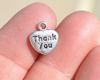 BULK 50  Silver Heart Shaped, Thank  You Charms SC1391