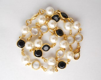 FAUX PEARL GOLDTONE metal, single strand necklace, clear and black faux rhinestones, dramatic contrasting color, formal or casual