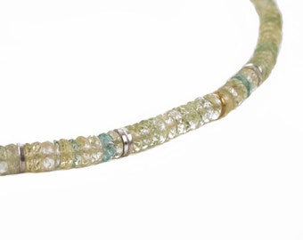 necklace of light green beryl with silver and gold