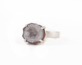 silver ring with a crystal agate druse