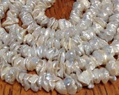 Pearls center drlled Keishi petals cream colored pearls half strand AAA grade