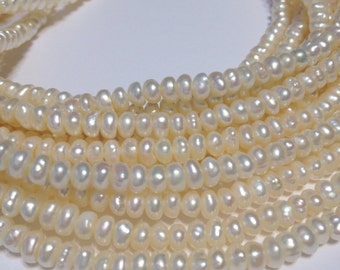 Pearls tiny rondelle shaped cream colored pearls whole strand
