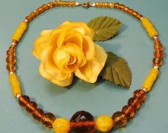 Lovely vintage 1940s grinded faceted translucent golden and strong yellow glass bead necklace with brass spring ring clasp