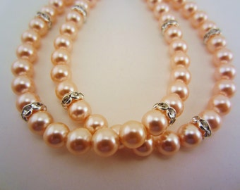 Pearl bracelet. Double strand with rhinestone spacers. Bridesmaid jewelry, gift for wedding party. Peach and silver.