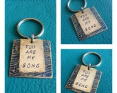 Chemically Etched Sheet Music Keychain with Brass Hand Stamped Quote