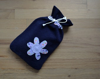 Hot water bottle cover in navy felted wool with flower