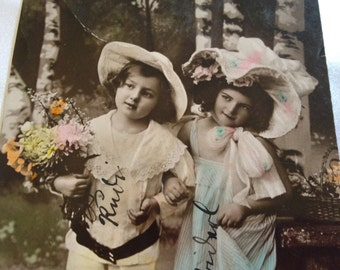 Antique German tinted postcard girls with hats and flowers