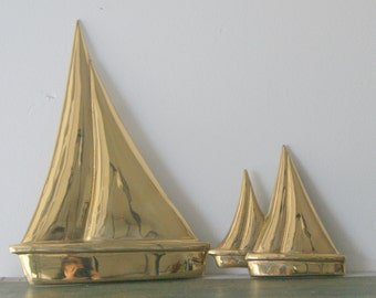 Pair of Brass Sailboat Wall Hangings.