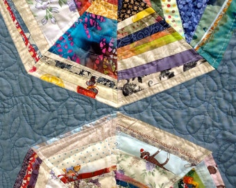 Quilt, Multi Colored Strips with Blue Background