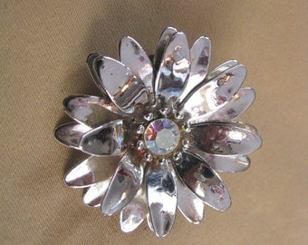 Shiny silver tone vintage layered flower pin brooch with rhinestone center