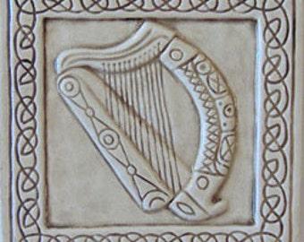 Decorative, relief carved ceramic Celtic harp tile