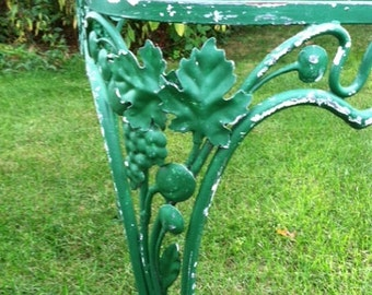 Vintage green dining or conference table, grape and vine detail