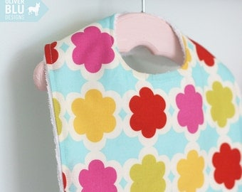 The Dressy Drooler Bib in geometric print - Hot pink, red, lime, gold and aqua