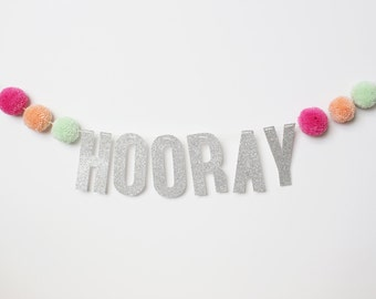 HOORAY banner with pom poms