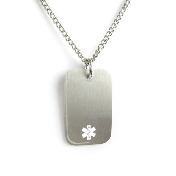 Silver medical ID dog tag with small white emblem