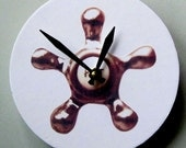 Small wall clock with an image of a spigot. H-O-T. Bathroom clock.
