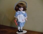 Vintage Porcelain Little Debbie Doll with Stand// 438